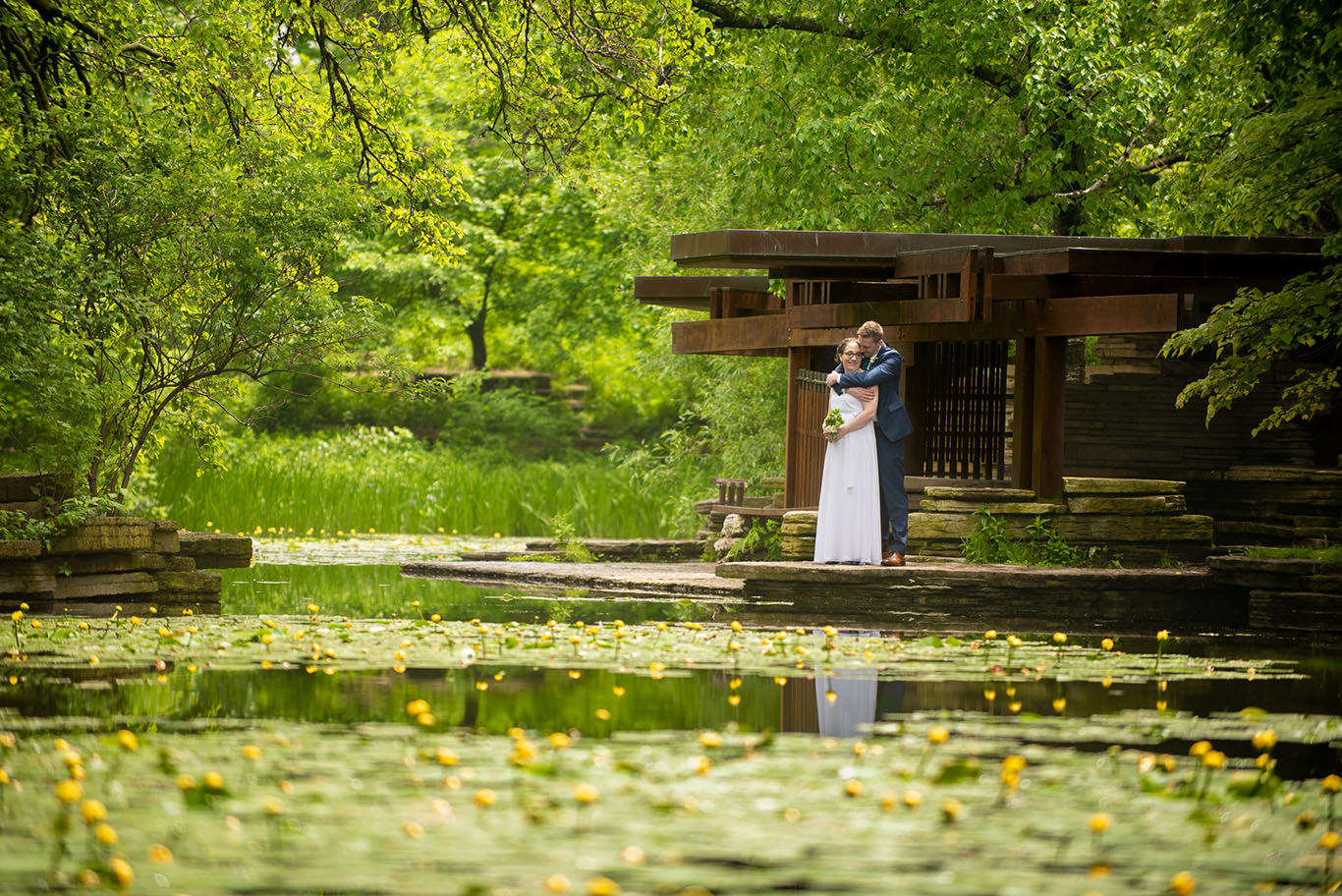 Bride and Groom hugging at the Alfred Caldwel Lily Pool in Chicago