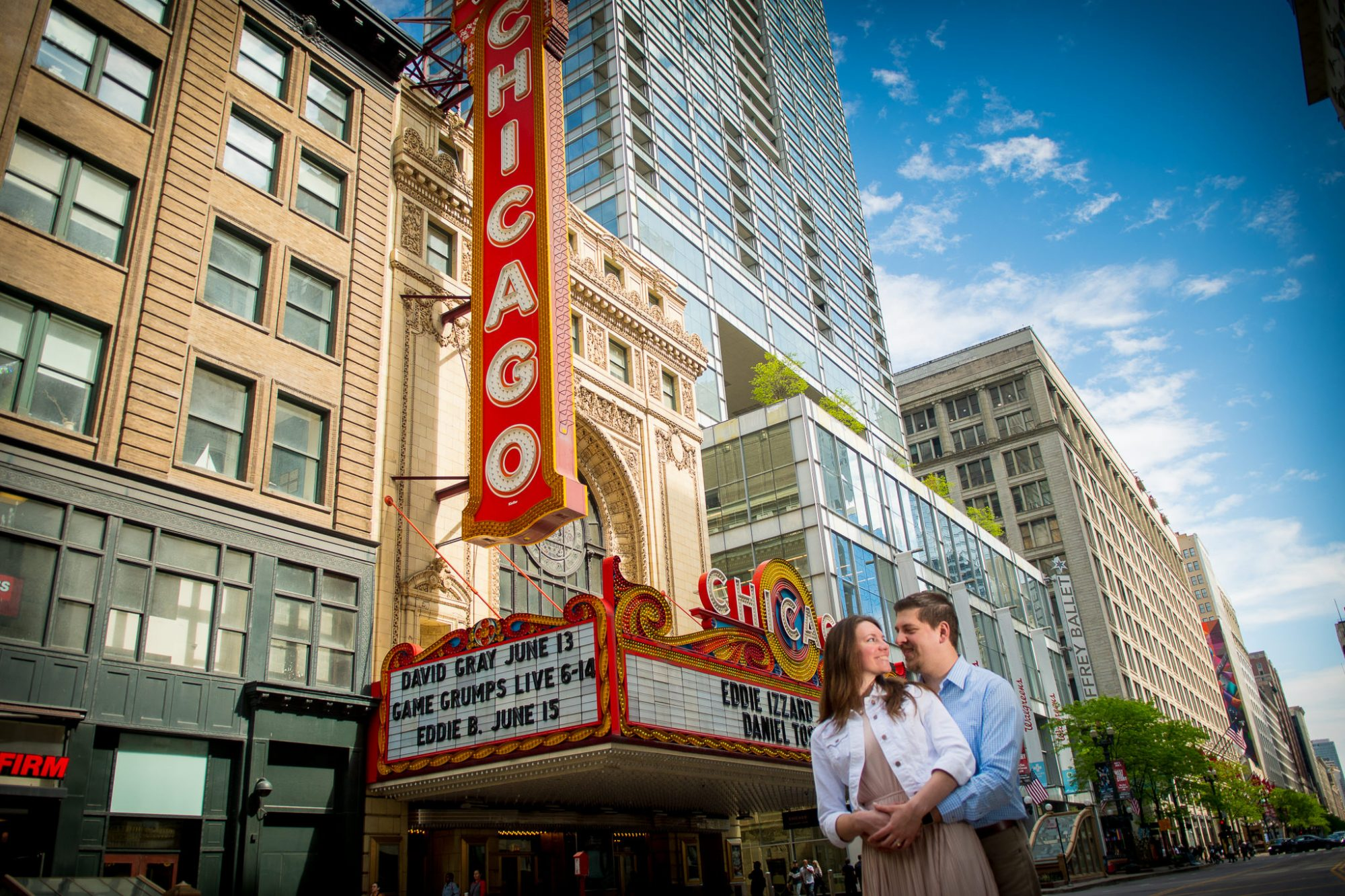 Engaged couple close together at the at the Chicago Theatre on State street