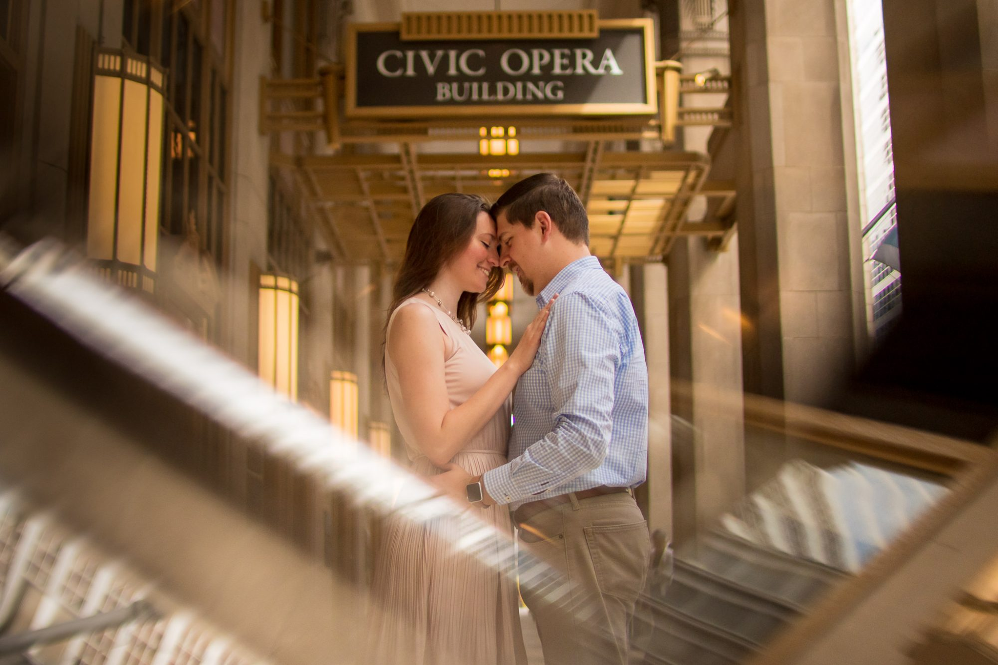 Engaged couple close together at the Civic Opera Building in Chicago
