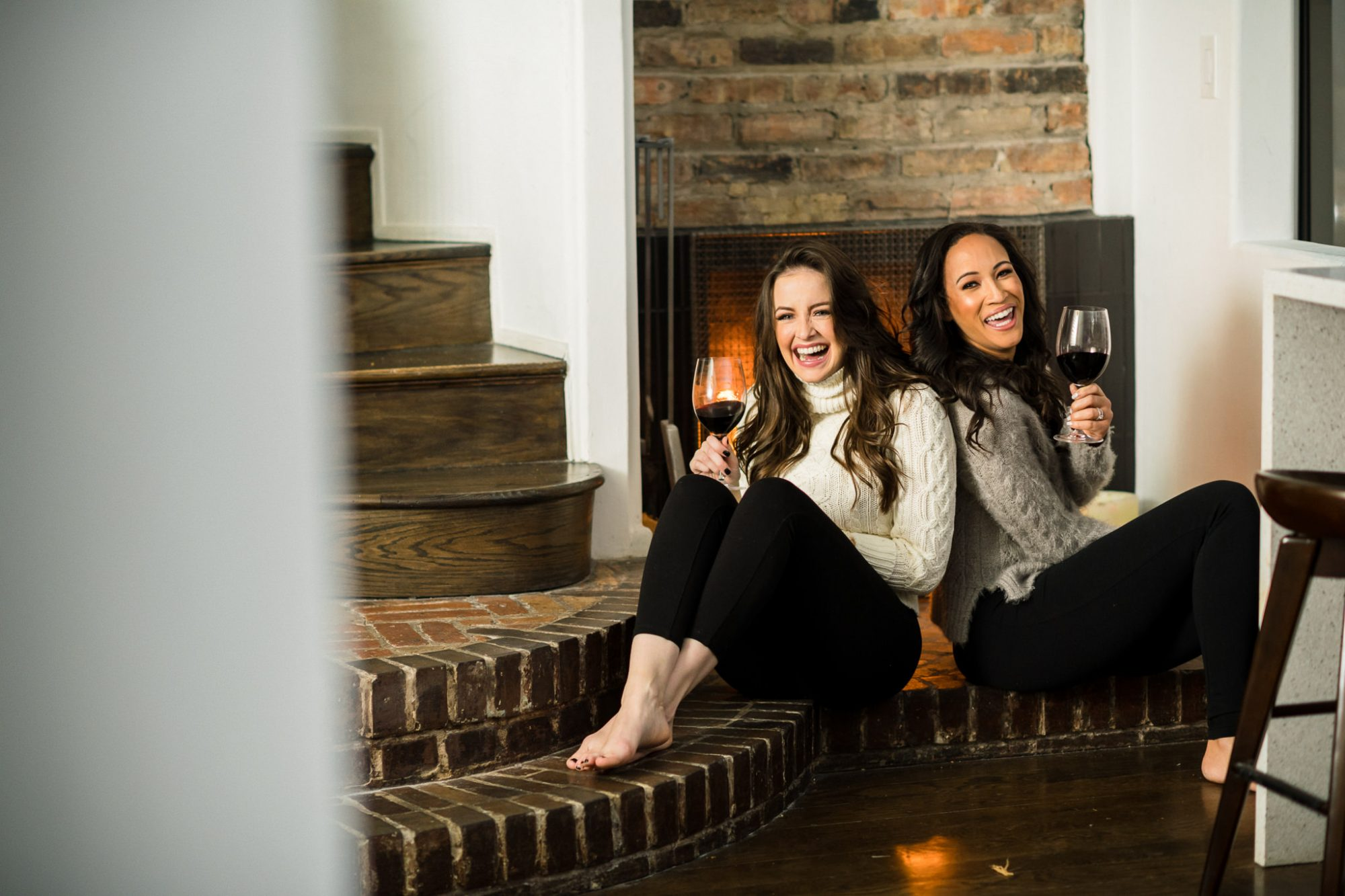 enjoying wine by the fire place friends chicago personal brand photography